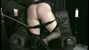 Naughty blonde is kneeling on the favorite chair in front of her guy, and sucking his dick