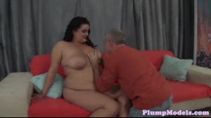 A lovely brunette plumper toying on a dong